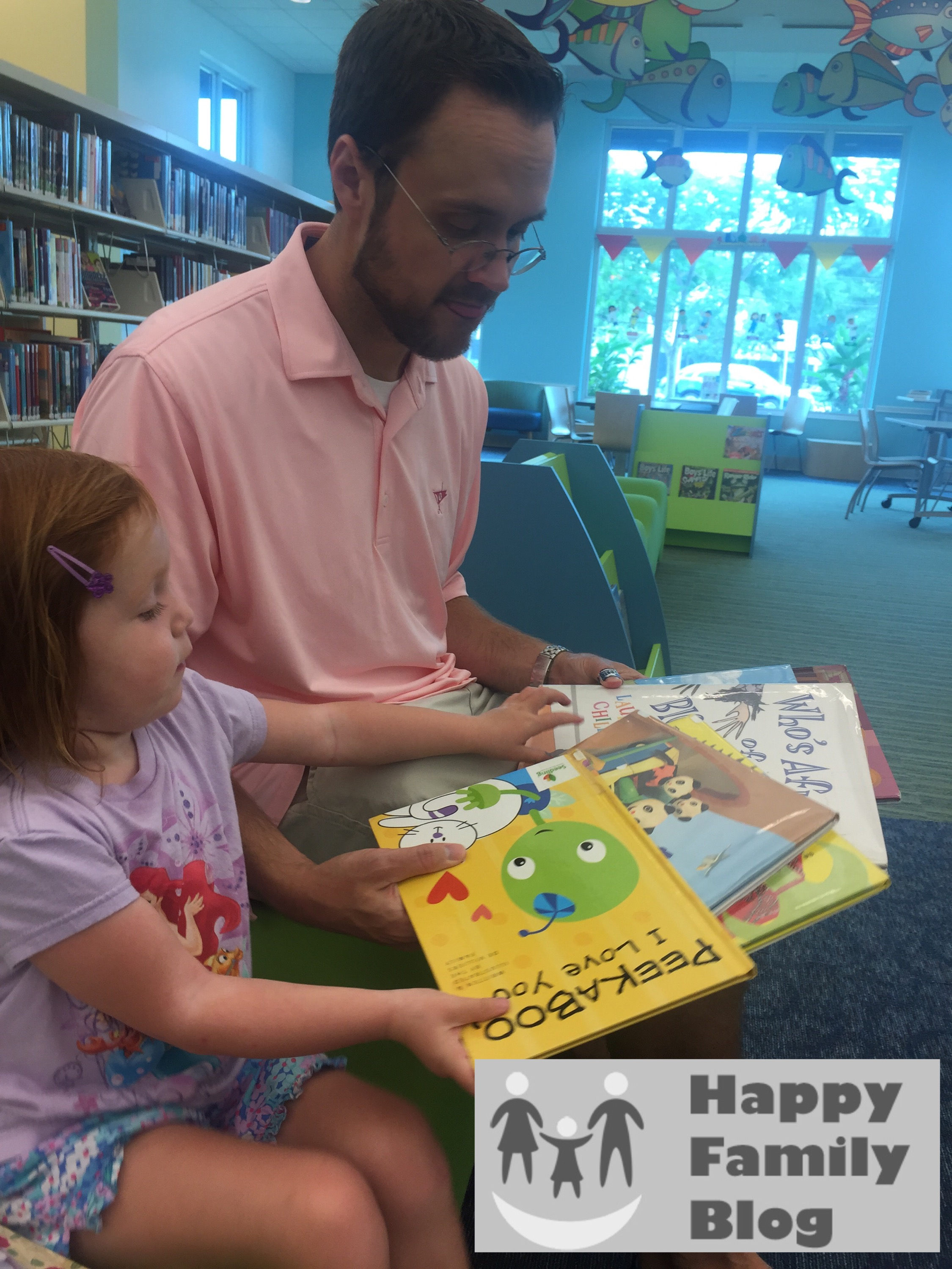 Picking out Library Books with Happy Family Blog